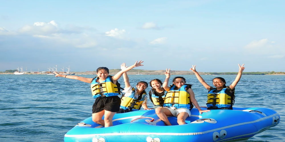 Pump Your Adrenaline by Playing Tubing Ride in Tanjung Benoa - Bali Tour Package